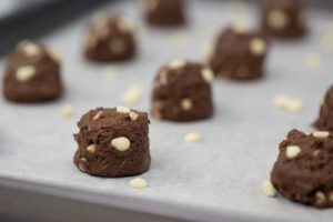 chocolate cookie drops on a sheet